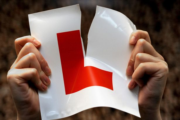 learner-driver-ripping-up-her-L-plate