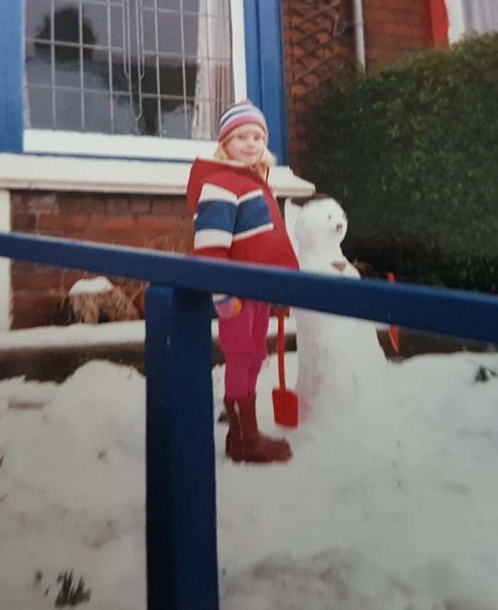 Scarlet child in snow